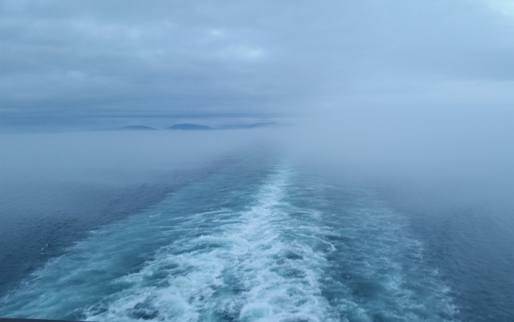 The ship's wake disappearing into the fog