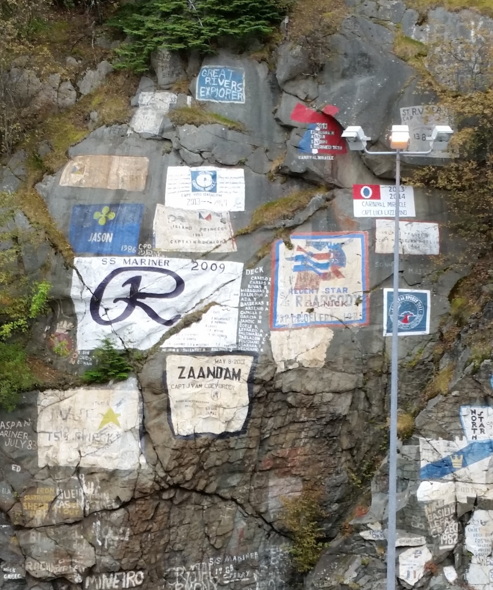 Shipping notices on the side of a cliff