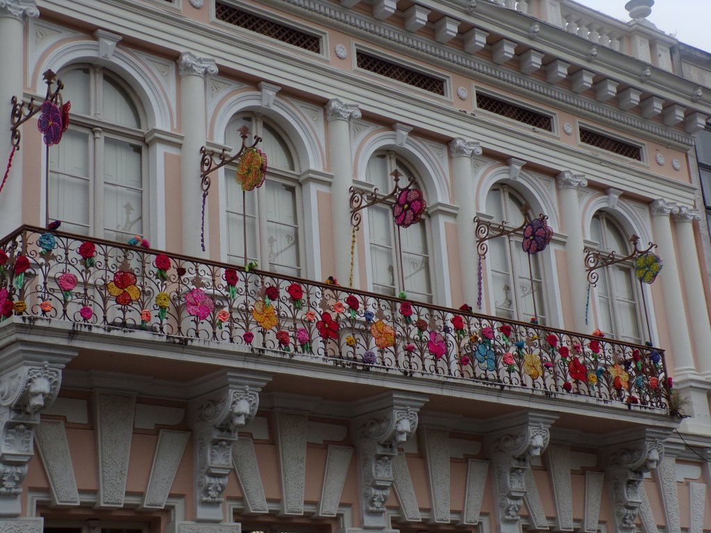 Balconies decorated with beautiful flowers.