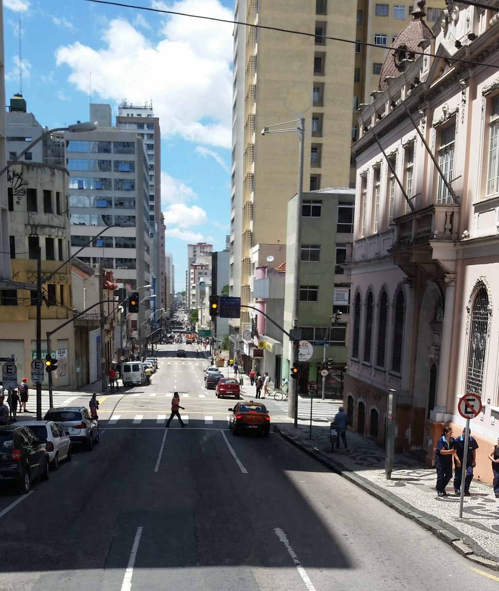 Downtown Curitiba contains modern highrises next to colonial style buildings.