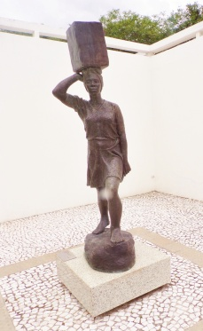 """Museum courtyard - statue of a woman carrying a heavy burden. Sculpture by Erbo Stenzel, 1944, """"Agua pro morro."""""""