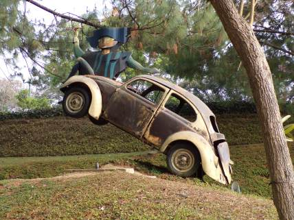 sculpture with car and guy