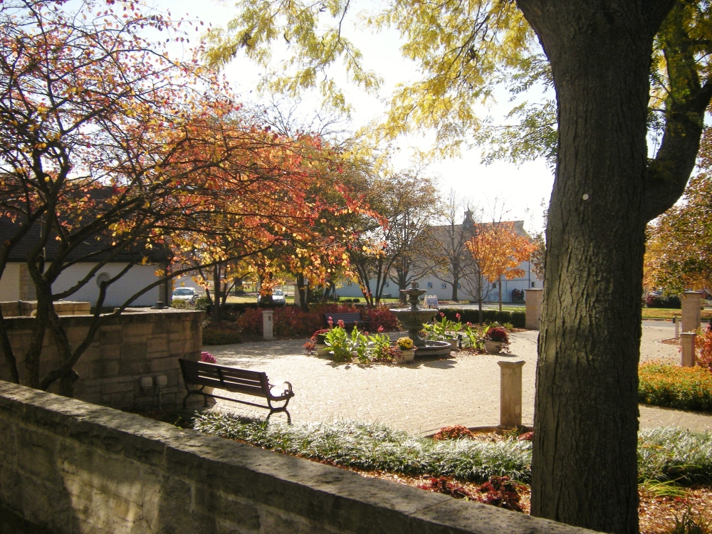 Danada House courtyard, with fountain and fall colors.