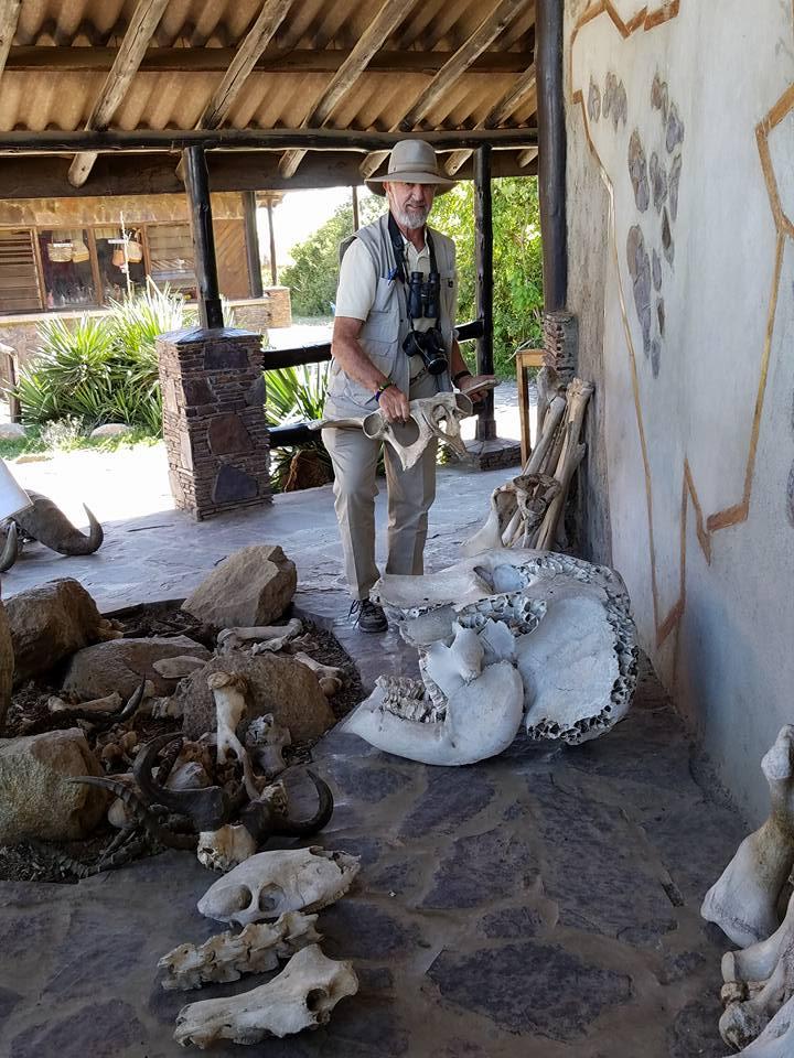 2-13 David with animal bones at Serengeti NP Visitors Center