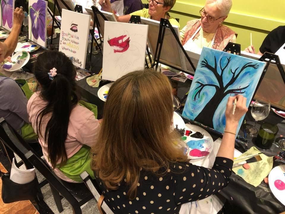 Mary paints a tree, Angela a dragon