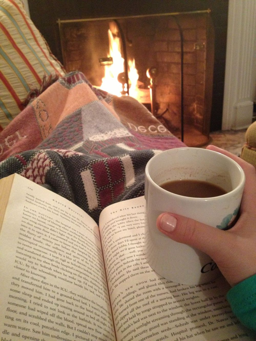 reading by the fire with hot chocolate.jpg
